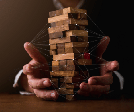 person holding up jenga tower