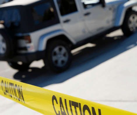 jeep wrangler with caution tape in foreground