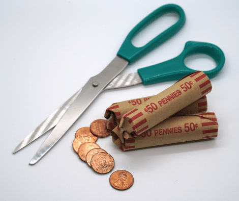 scissors and coins