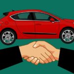 shaking hands car purchase